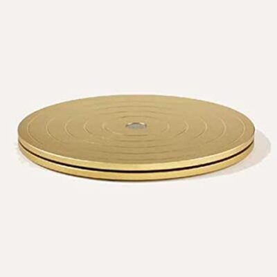 """This metal spinner is an off-ice training device designed to improve balance and spinning technique. Quiet and smooth. 6.25"""" diameter."""